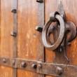 iron knocker on an old door of a monastery