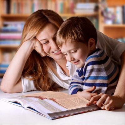 Mother reading Bible stories to her boy